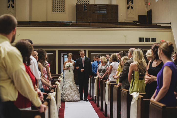 Laura coming down the aisle with her father at their church in Des Moines, Iowa