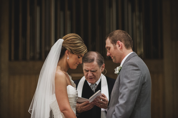 Laura and Ryan exchanging vows at their church in Des Moines, Iowa