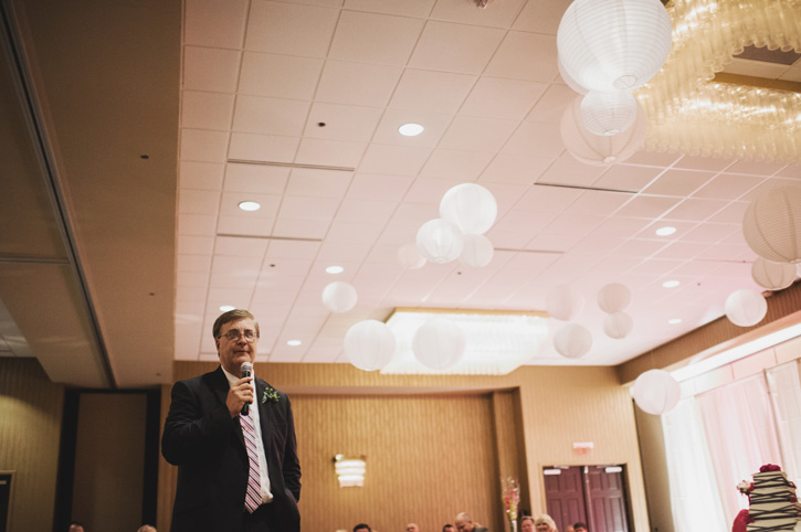 Laura's father giving a speech at Embassy Suites in Des Moines, Iowa