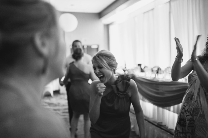 Guests dancing and making faces during the reception at Embassy Suites in Des Moines, Iowa