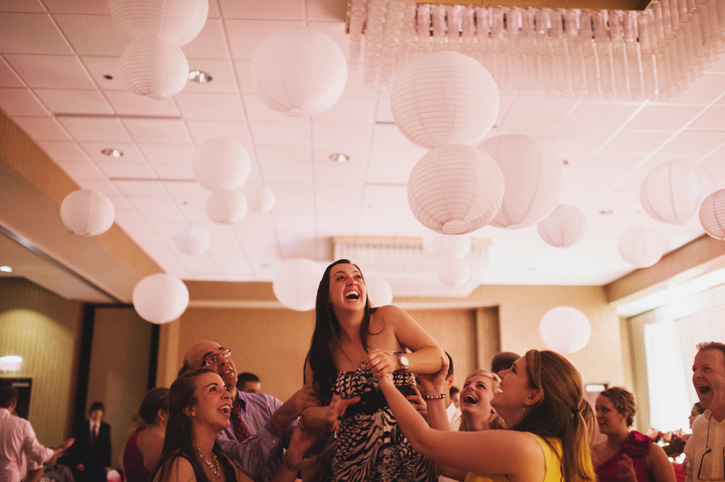 A girl dancing and singing during the reception at Embassy Suites in Des Moines, Iowa