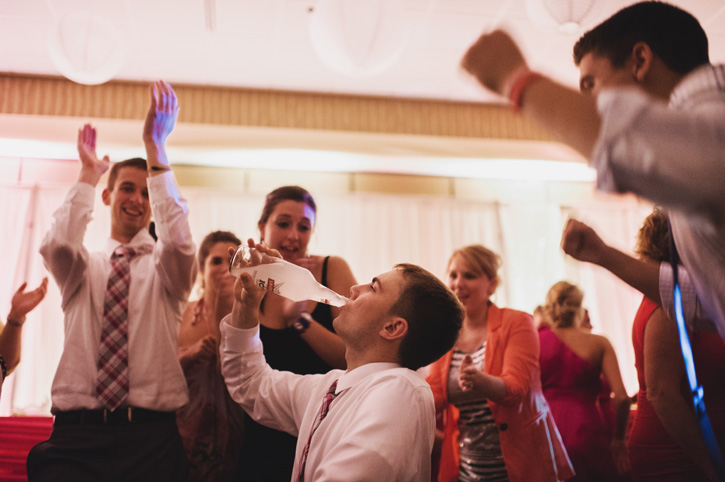 A groomsman getting iced and drinking Smirnoff Ice during a reception at Embassy Suites in Des Moines, Iowa