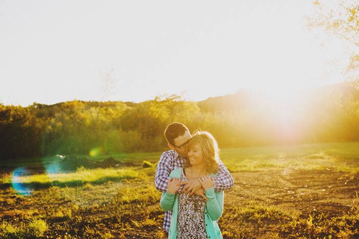 cassie and jeff kissing at saylorville during their des moines iowa engagement session