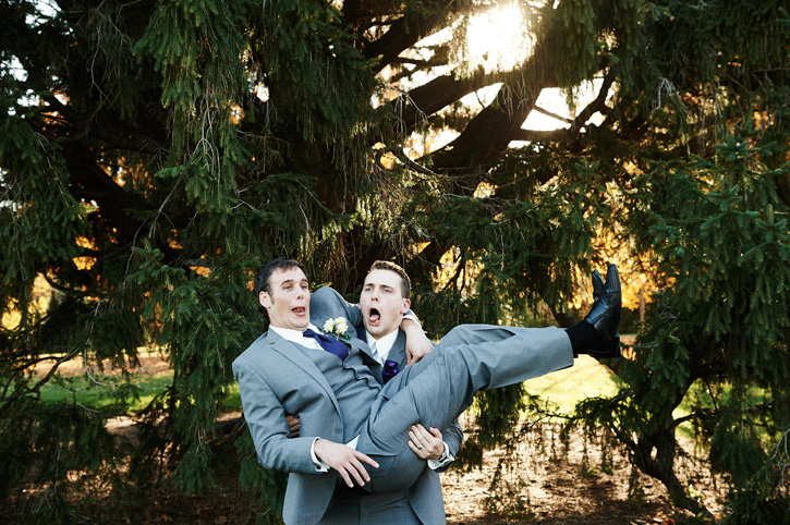 Shaun's groomsman surprises him by jumping into his arms | Ames Iowa Wedding and Portrait Photographer Brian Davis