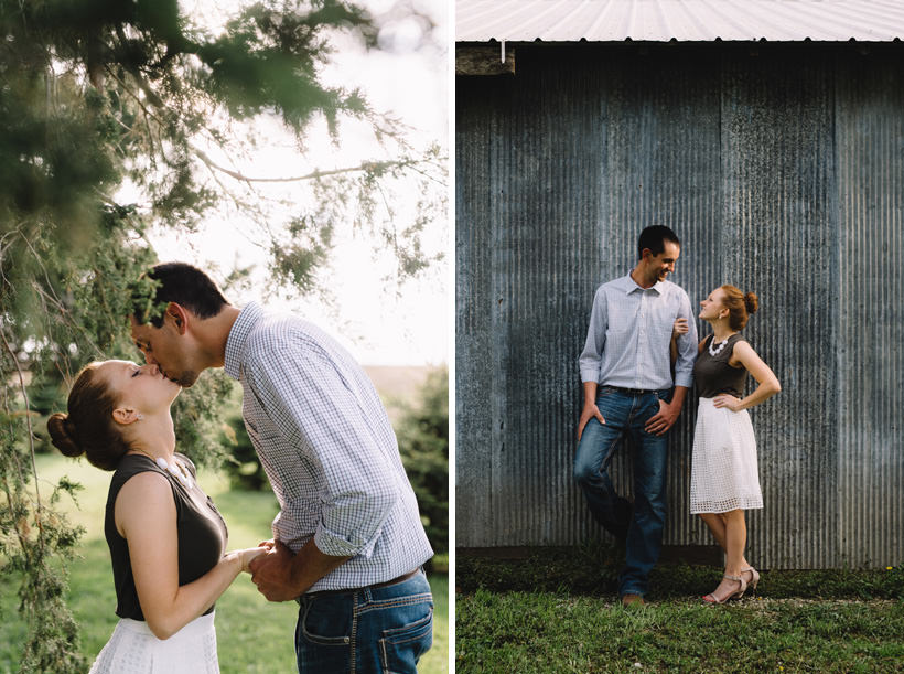 Erin and Scott share a kiss near a rustic shed