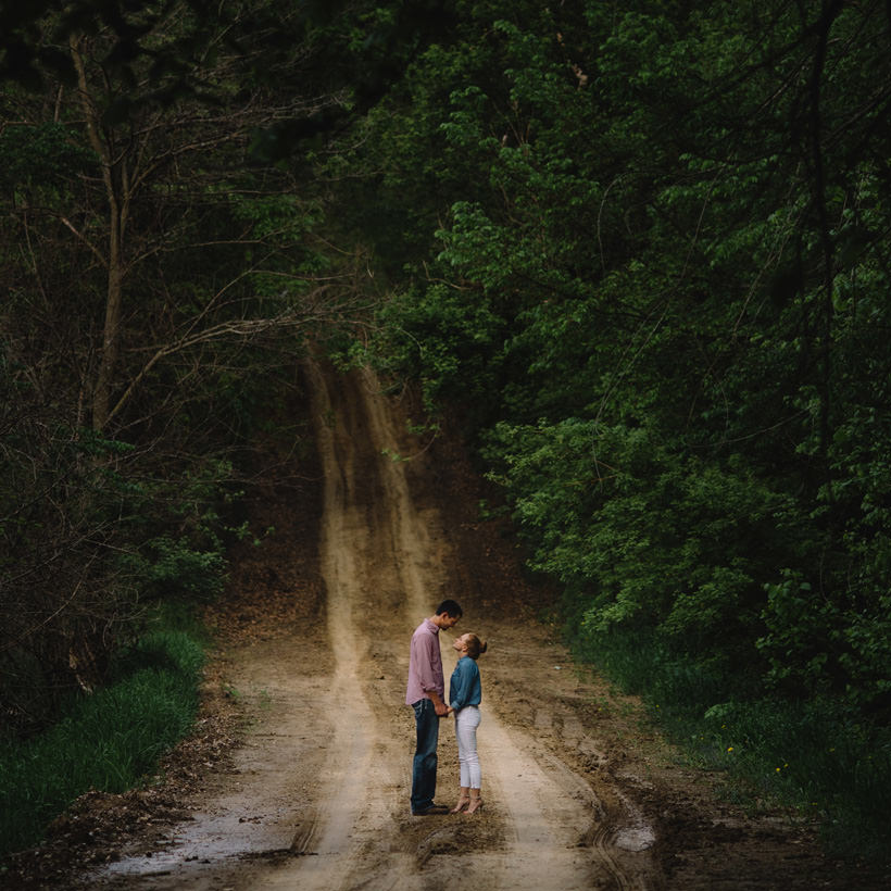 Erin and Scott on a lonely road through the woods