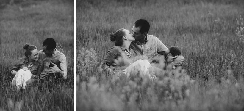 Erin and Scott huddled in a field with flowers
