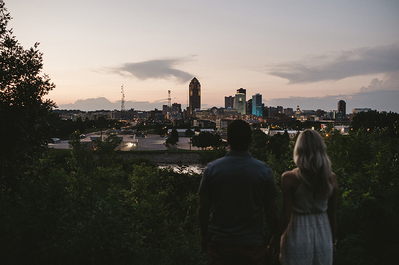 Chrissy and Joe look out over the city of Des Moines | Des Moines Iowa Wedding Photographer Brian Davis