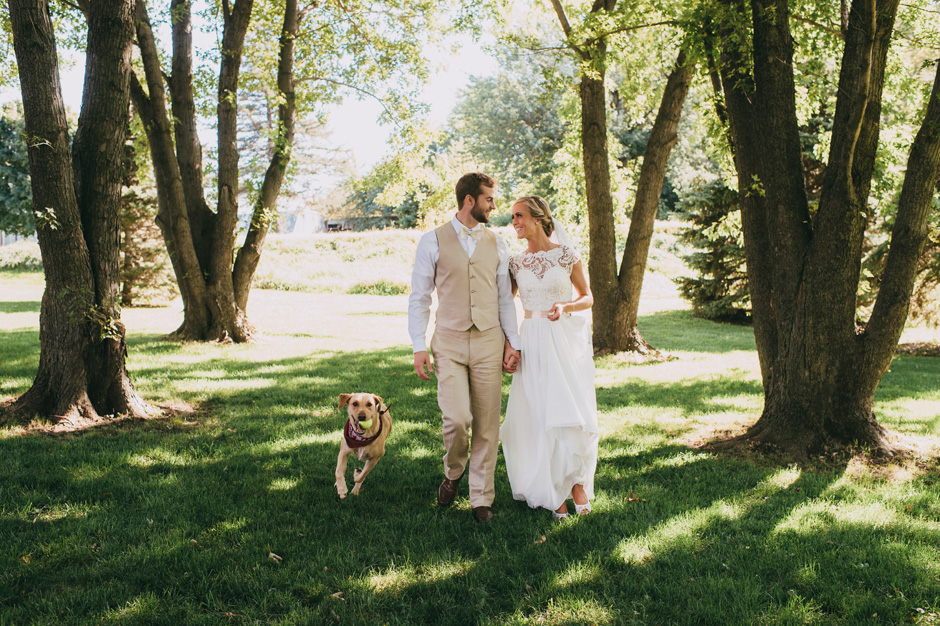 The bride and groom's dog Hana dashes through the frame during portraits