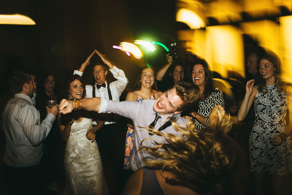 An energetic guest does the whip during Blake and Justin's Emmetsburg, IA Wedding