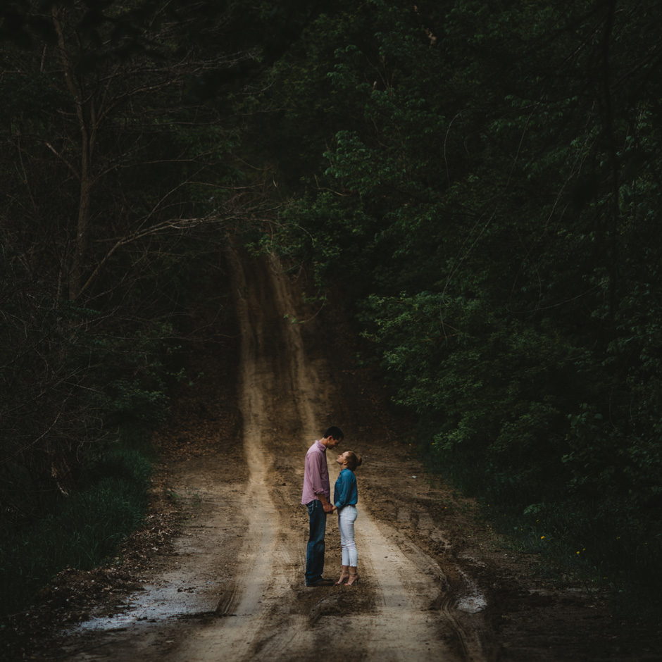 Erin and Scott in a dramatic woodland scene during their rustic Victor, IA engagement