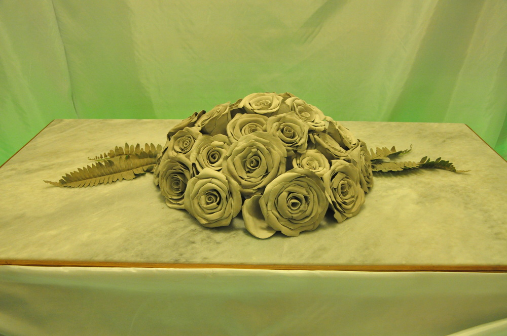 Bed of Roses II  (installation view), 2015, Marble, clay, and neon light, 16 x 56 x 54 inches