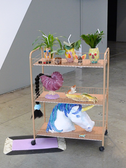 Beverage Cart  , 2015, rolling cart, wood, glazed ceramics, found objects, synthetic hair, live plants, plastic straws, and foam, 38 x 26 x 20 inches.