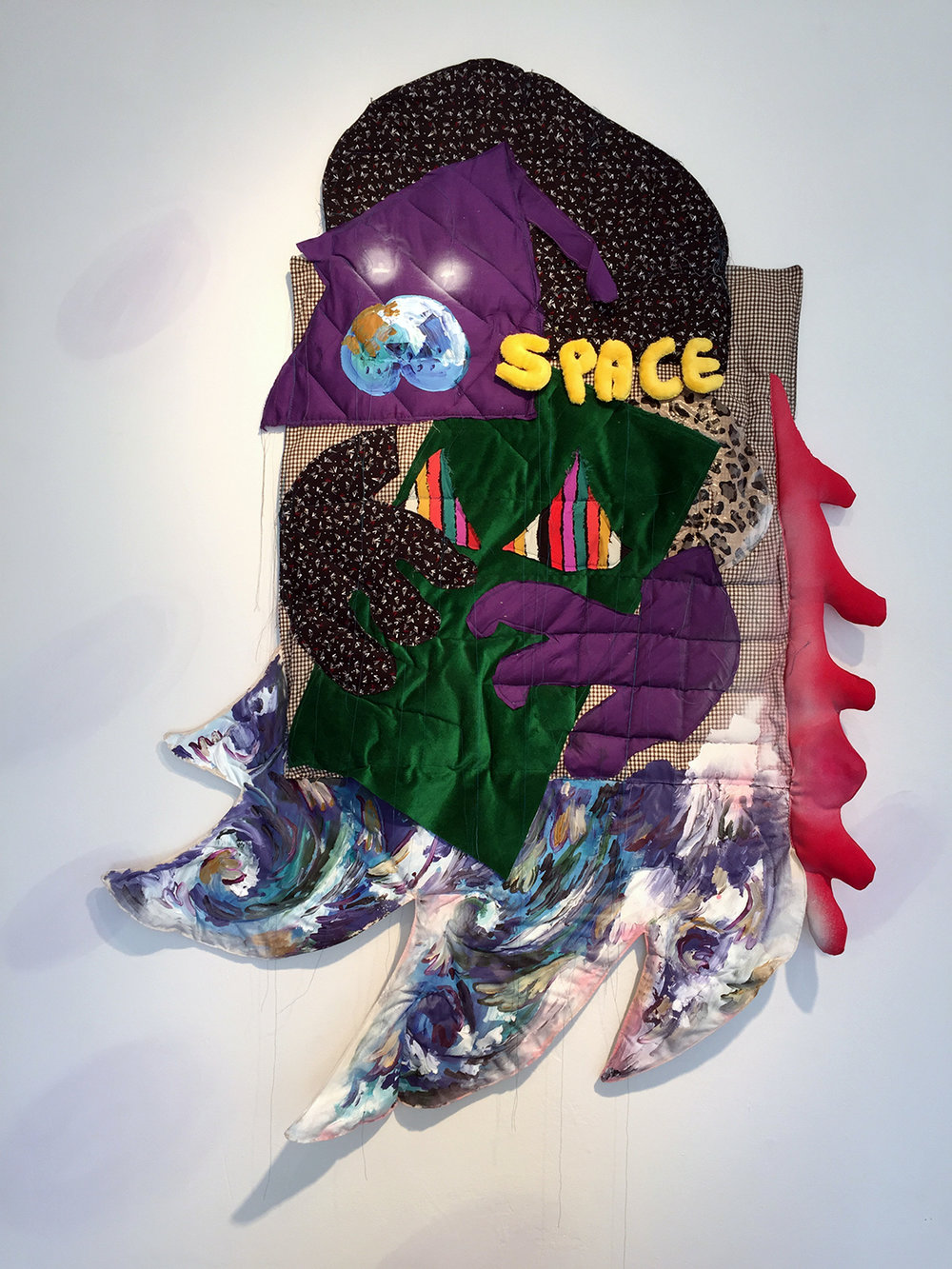 Space Dog  , 2015, fabric, batting, thread, plastic bag, latex, and acrylic and spray paint, 40 x 80 inches.