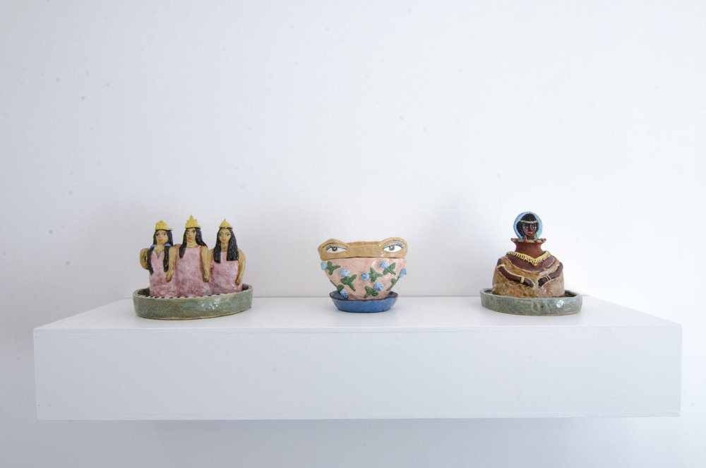 Bratae Birkhada  (dancing girls), 2017, Glazed ceramics, 10.25 x 11.75 x 10 inches   Simta  (A box to stick money in), 2017, Glazed ceramic pot and lid, 7 x 8.75 x 6.75 inches   Nashiram  (hunter), 2017, Glazed ceramic, 9.75 x 9.25 x 8.75 inches