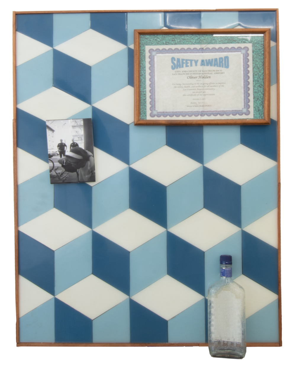 Safety Award,  2018, 36.25 x 27.5 x 4 inches, Acrylic painted wood and resin- on panel, Seagram's gin bottle, personal photograph, and safety award