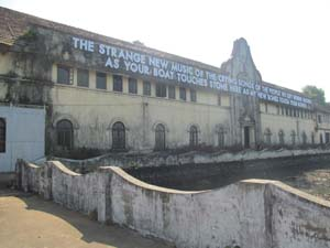 15 Biennale & beyond: Kochi-Muziris, South India ROMAIN MAITRA Robert Montgomery, LED-lit text-based work on the wall of Aspinwall House, Fort Kochi, as part of Kochi-Muziris Biennale, 2012/13; image courtesy the artist; photo by Romain Maitra