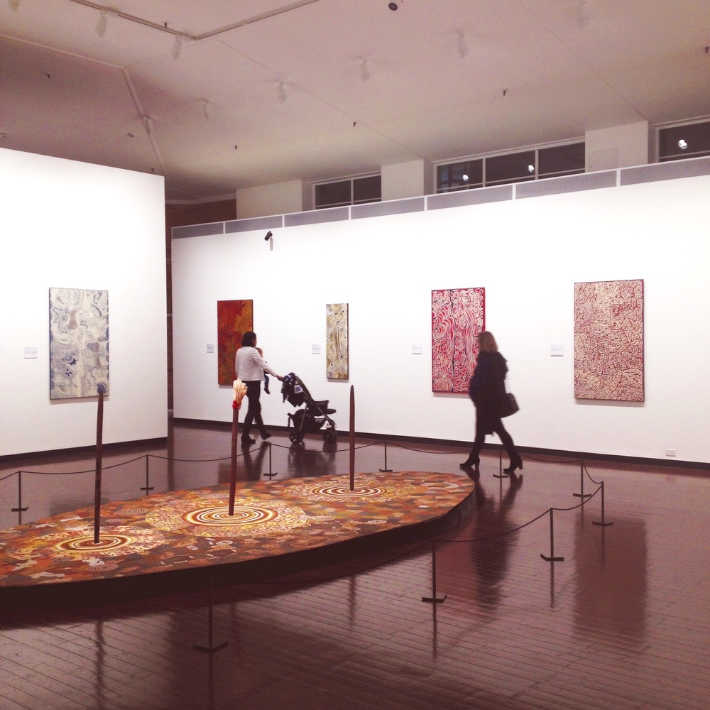 Visitors at the 'Streets of Papunya' exhibition showing at the Drill Hall Gallery, canberra