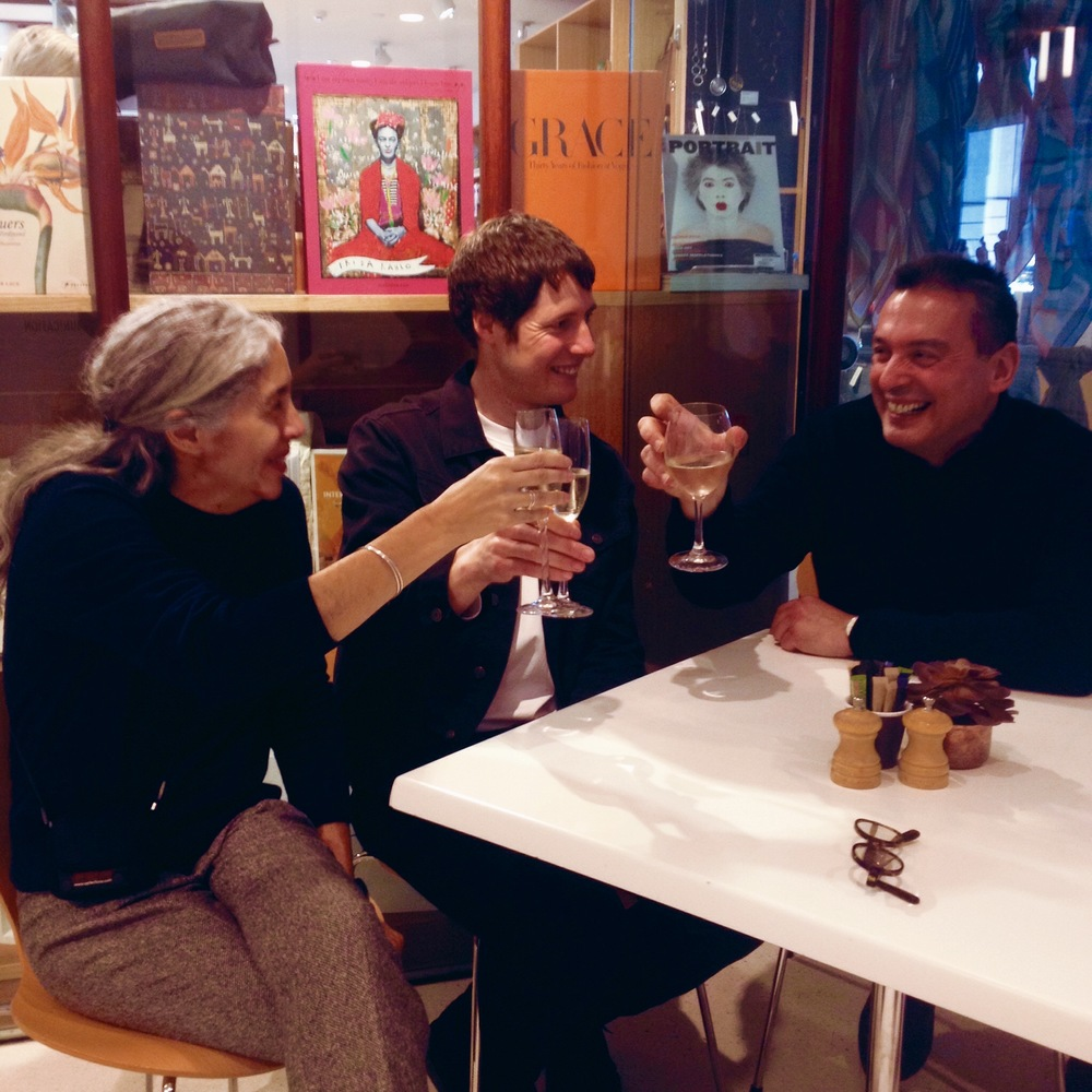 Christos Tsiolkas toasting with artists Warwick Baker and Rozalind Drummond