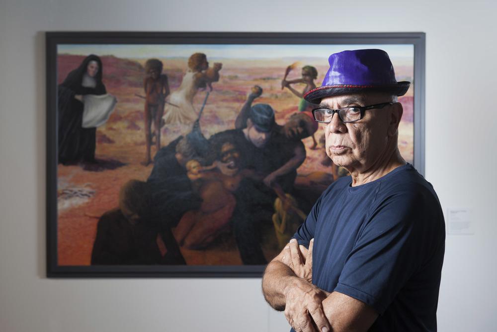 Harold Joseph Thomas (Bundoo) with his work Tribal Abduction, overall winner of the 2016 Telstra Art Award