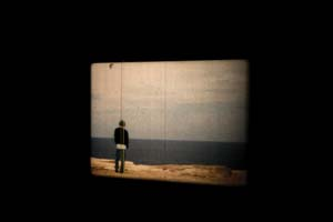2 Todd McMillan: Ten Years of Tears CARRIE MILLER Todd McMillan, By the Sea, 2004, cinematographer: Andrew Liversidge; 16mm film, 1min:12sec, looped, installation viewTen Years of Tears, MONA, 2013; image courtesy the artist and MONA Museum of Old and New Art, Hobart; photo: MONA/Rémi Chauvin