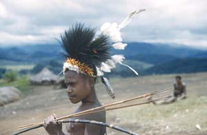 11 Through the Kunai Grass, Portraits of New Guinea Highlands 1951-53, Berndt Museum EMILIA GALATIS Portrait of a young man holding bow and arrows, near Kainantu, Eastern Central Highlands PNG, 1951