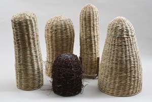 16 Virginia Kaise 1945-2012 ANTHONY CAMM Virginia Kaiser, Shapes in the Landscape, 2010, bulrushes and rattan; Muehlerbeckia and rattan; photo: Boris Hlavica
