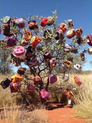 7 Desert winter HANNAH KOTHE    The Beanie Tree, Uluru ; image courtesy the Alice Springs Beanie Festival