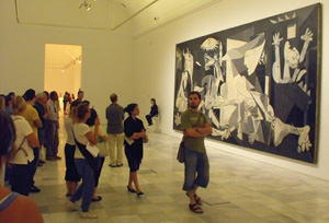 14 Madrid and the essential youthfulness of art MATTHIAS KRUG    Crowds gather in front of the Picasso's  Guernica  at the Reina Sofia museum.
