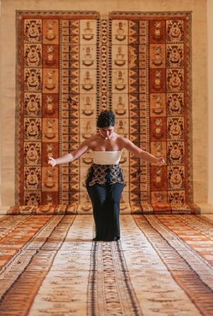 Ruha Fifita performing traditional Tongan dance in the exhibition 'Siu i Moana: Reaching Across the Ocean', NGV International, Narrm Melbourne, June 2016; photo: Wayne Taylor