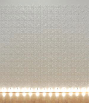 3 Xstrata Coal Emerging Indigenous Art Award 2006: JEREMY ECCLES   Jonathon Jones, Kamilaroi,Wiradjuri people,  Lumination fall wall weave , 2004/06, electrical cable, light fittings, bulbs and MDF board. Collection of the artist. Courtesy of Gallery Barry Keldoulis, Sydney