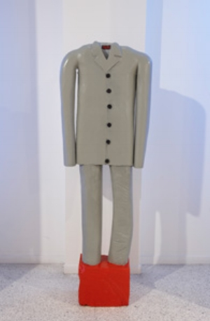3 Making it New: ADAM GECZY   Bob Jenyns,  Suit… dedicated to my dad who waited for forty years for me to buy a suit and then he died so that I might have somewhere to wear it , 1995, polychromed wood, 60 x 240 x 23cm. Installation view, Museum of Contemporary Art, Sydney. Collection the artist. Image courtesy and © the artist