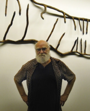 7 Ian Gentle, 1945-2009: GINA FAIRLEY   Ian Gentle in front of his work  Salivating Croc  at Wollongong University Library. Photograph by Gina Fairley