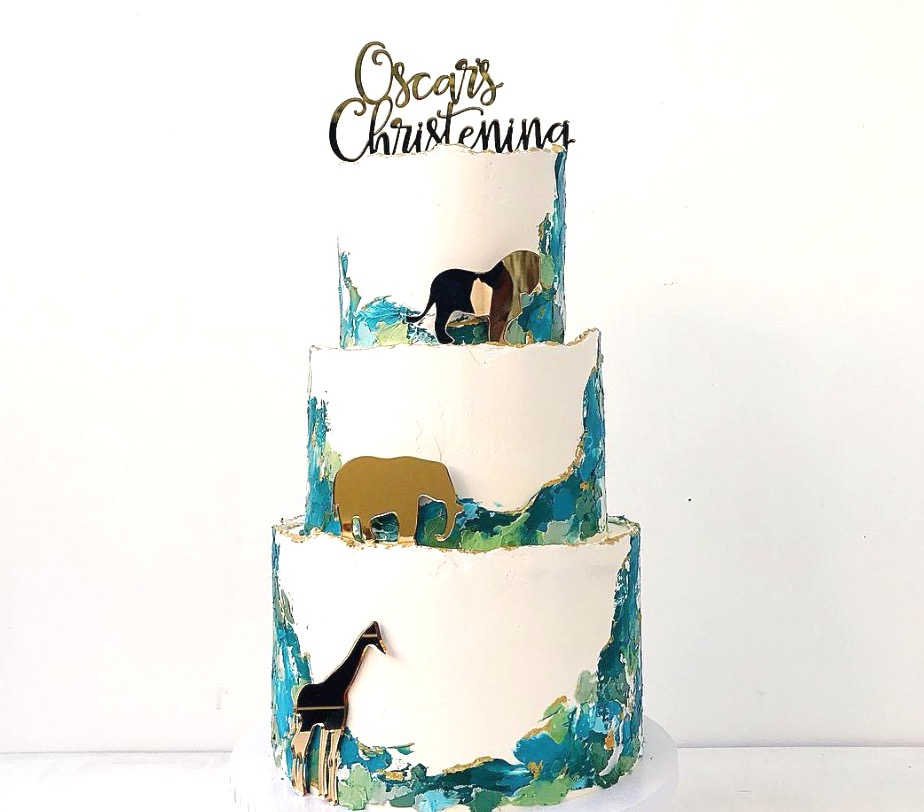 Extra details to help make the cake & event unique - buttercreme landscape cake by @buttercreambakery and gold safari animals & cake topper by @communicakeit