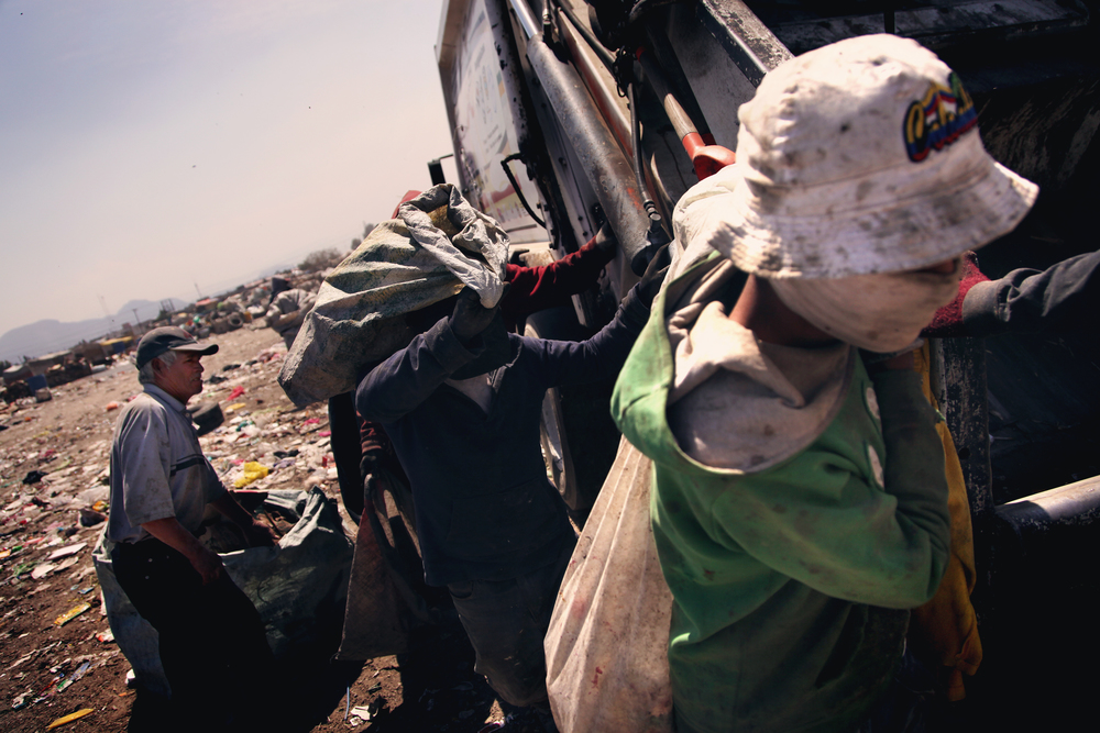"Pepenadores, or ""waste pickers"", operate in the landfills on the outskirts of Mexico City, where they often live with their families."