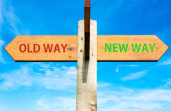 old-way-new-way-signs-life-change-conceptual-image-wooden-signpost-two-opposite-arrows-over-clear-blue-sky-49033671.jpg
