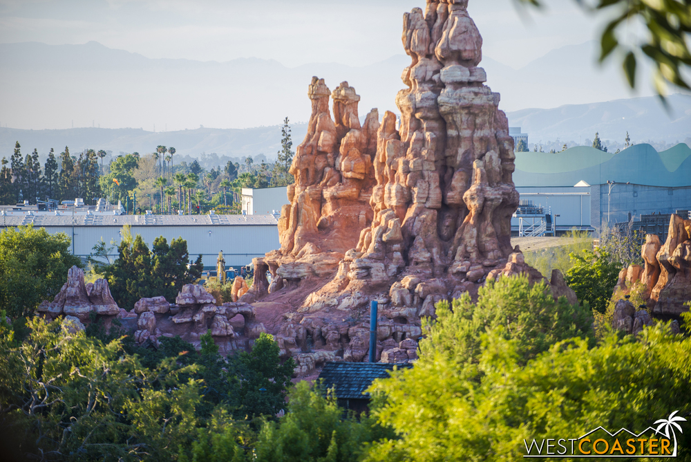 """Star Wars"" Land is rather obscured by Big Thunder Mountain, but you can see some equipment and more dirt."