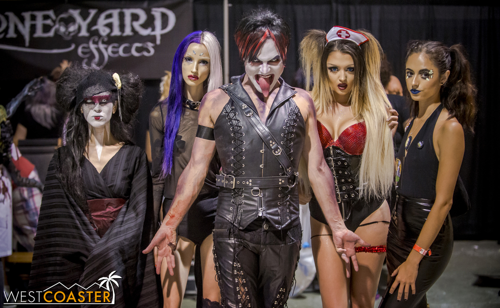The Ghoulmaster with his macabre maidens.