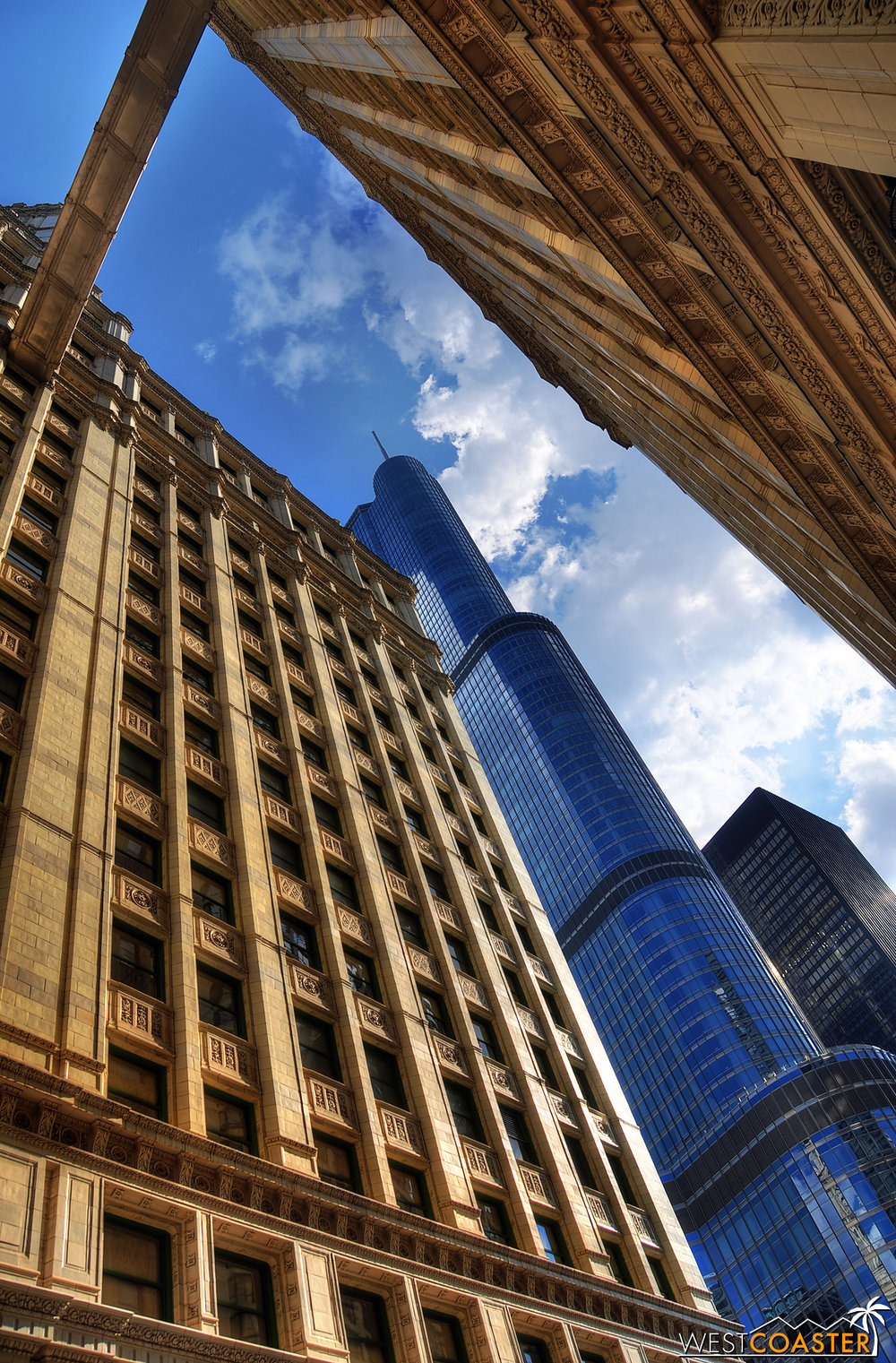 The sleek, glistening, and flashy Trump Tower looms behind the view created by the classic Wrigley Building.