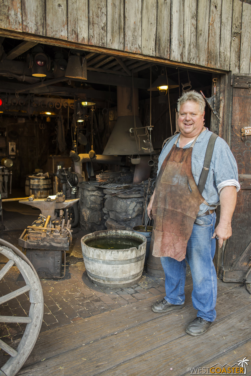 The blacksmith poses for a picture while taking a brief break from his work.