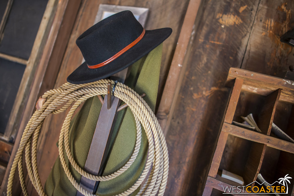 A hat and lasso hang on a rack for Sheriff Wheeler's use when needed.