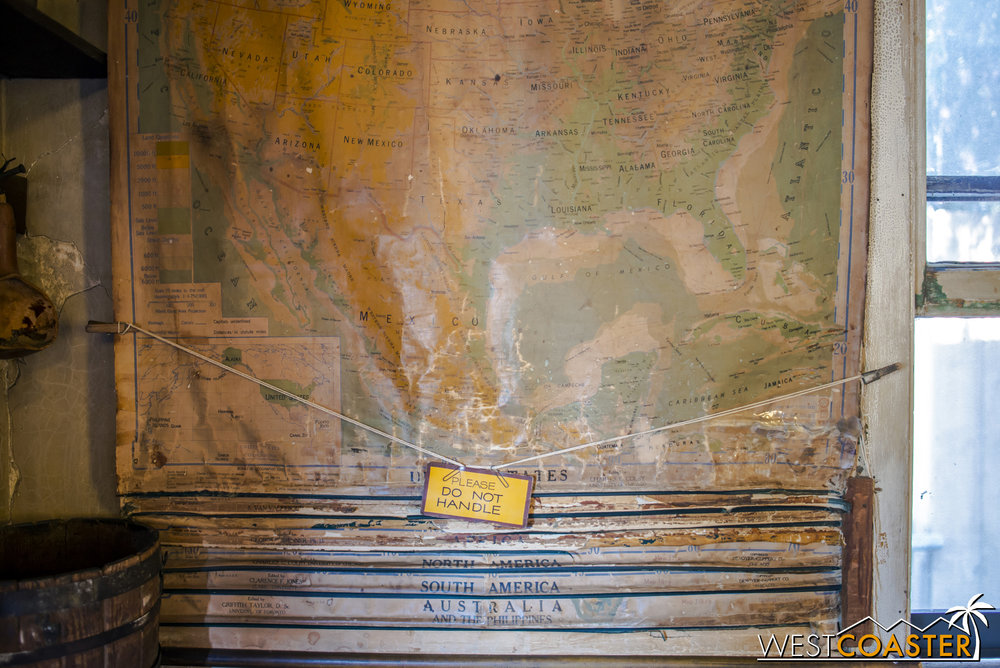 An old map hanging on the side.