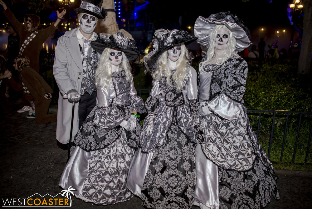 A ghostly Haunted Mansion family poses for photos at Mickey's Halloween Party.