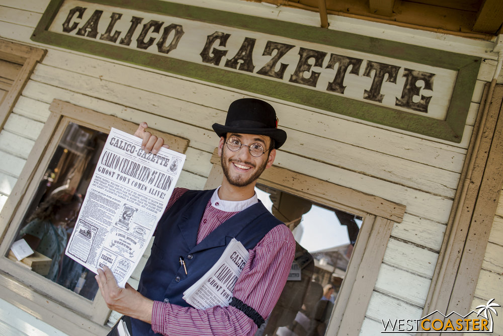 The  Calico Gazette  editor poses with the latest edition of the paper.