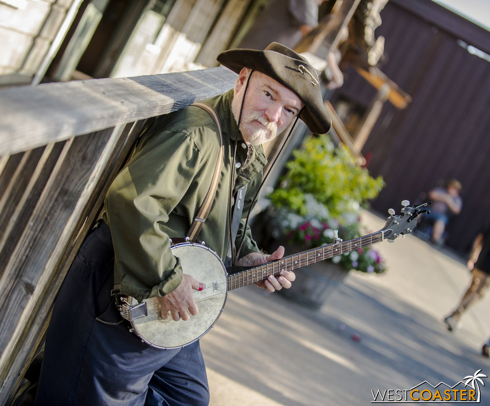 "Prospector ""Cannonball"" plays the banjo when he is not panning for gold."