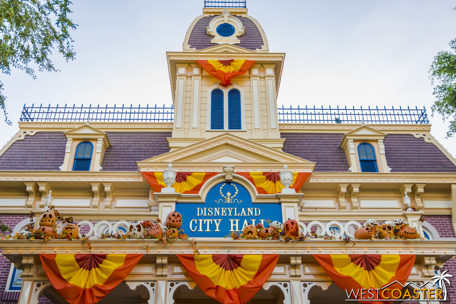 buildings across main street are adorned in halloween decorations