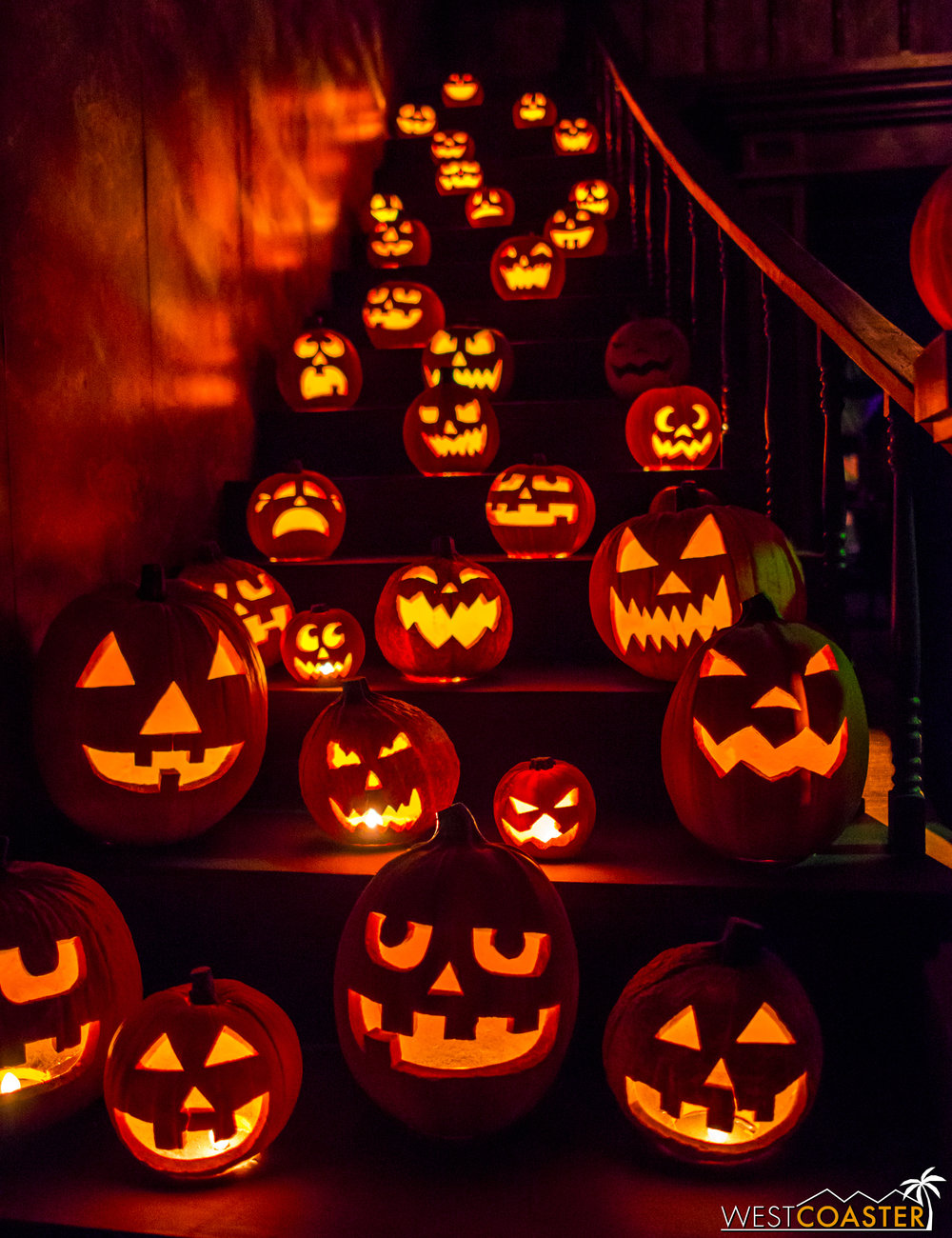 The dramatic jack-o-lantern staircase unfolds as guests walk in.