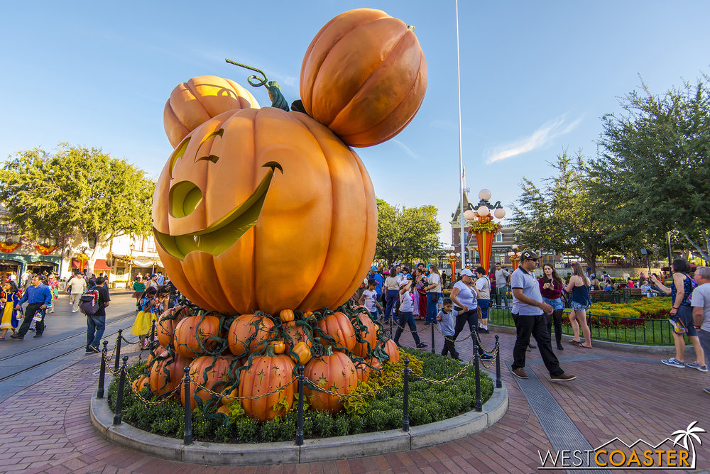 Early on, Halloween Party guests line up to get their photos taken in front of the big Mickey Pumpkin.