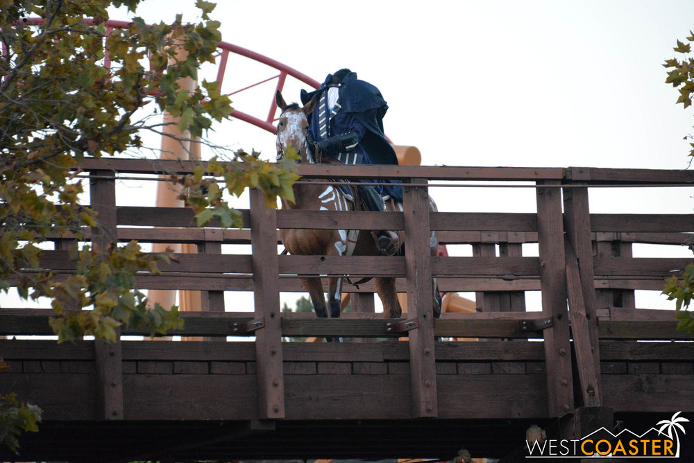 And before the event begins, the Headless Horseman takes a trot over the Stagecoach bridge to observe the evening's victims--er, guests.