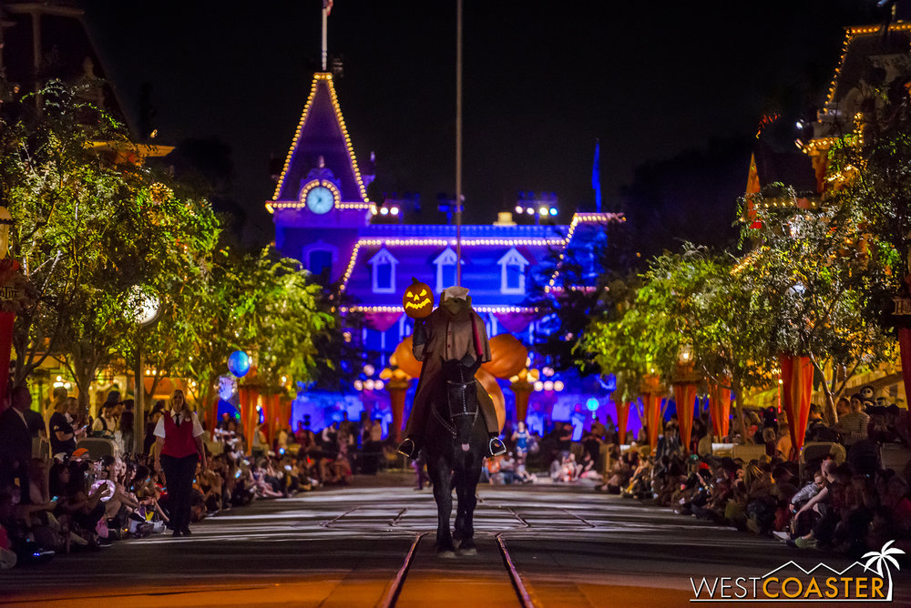 Adopting a modified form of Disney World tradition, the parade opens with the Headless Horseman.